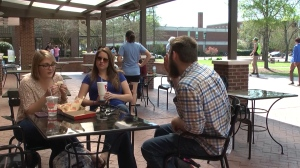 students eating fast food at a table at new patio
